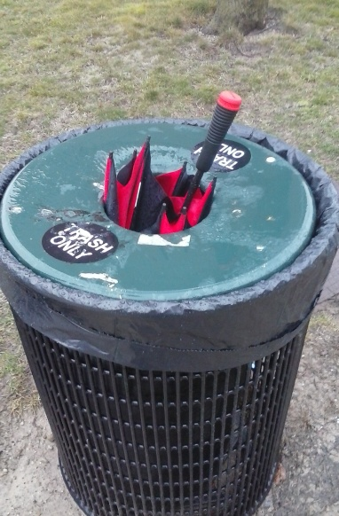 Umbrella in the trash