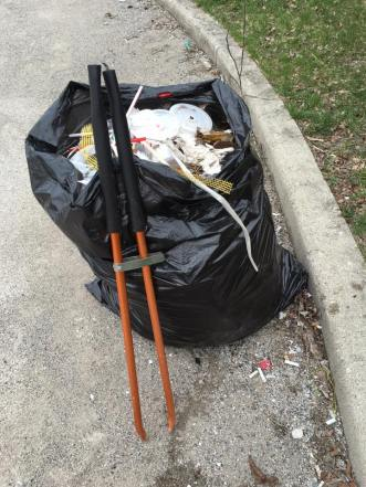 Keeping Muncie Beautiful service project picking up trash around Downtown Muncie